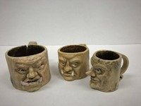 Three mugs with faces